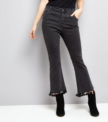 Black Pom Pom Trim Flared hem Jeans