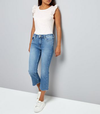 Petite Blue Cropped Raw Hem Flared Jeans