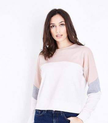 Sweat design color block rose pâle