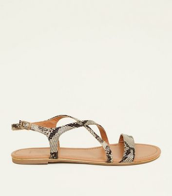 Wide Fit Brown Faux Snakeskin Metal Edge Flat Sandals by New Look