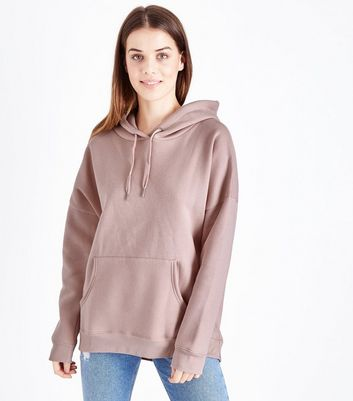 Sweat à capuche rose clair oversize