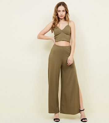 Khaki Ribbed Flared Split Side Trousers 				  				 					 				 			 			 					Khaki Ribbed Bralet by New Look