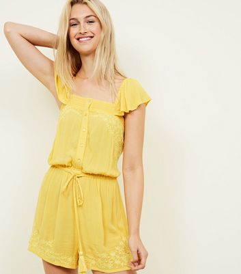 Mustard Floral Embroidered Tassel Tie Playsuit