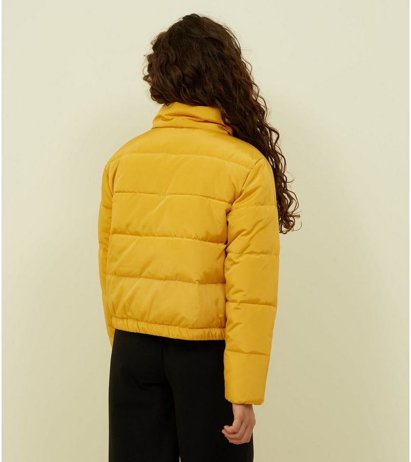 0bf4ee082661 New Look Girls Mustard Funnel Neck Puffer Jacket at £22.49