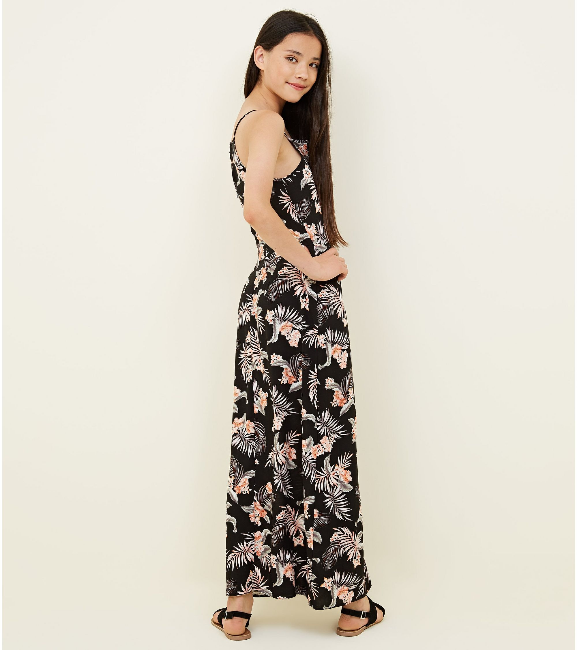 e17b5fb9680 New Look Teens Black Tropical Dip Hem Maxi Playsuit at £10