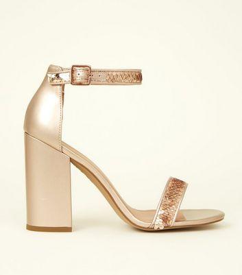 ab5d6a3b3e37d Shoptagr   Rose Gold Metallic Sequin Strap Block Heels by New Look