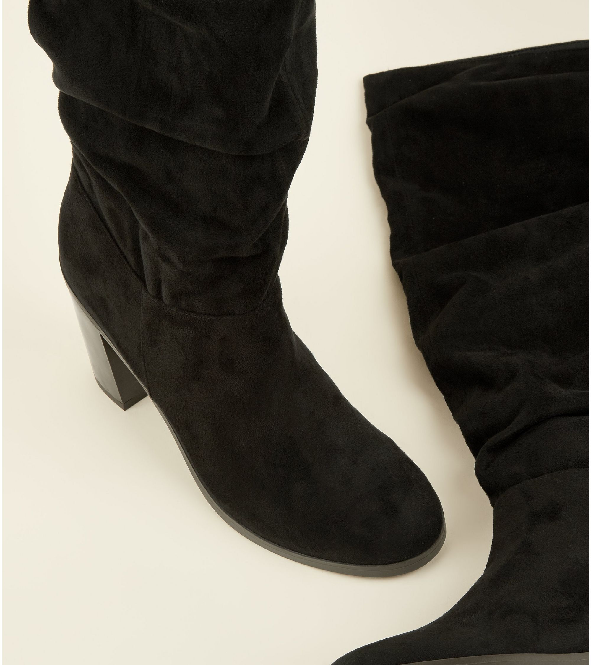 5825a1b85ce New Look Black Block Heel Knee High Slouch Boots at £39.99