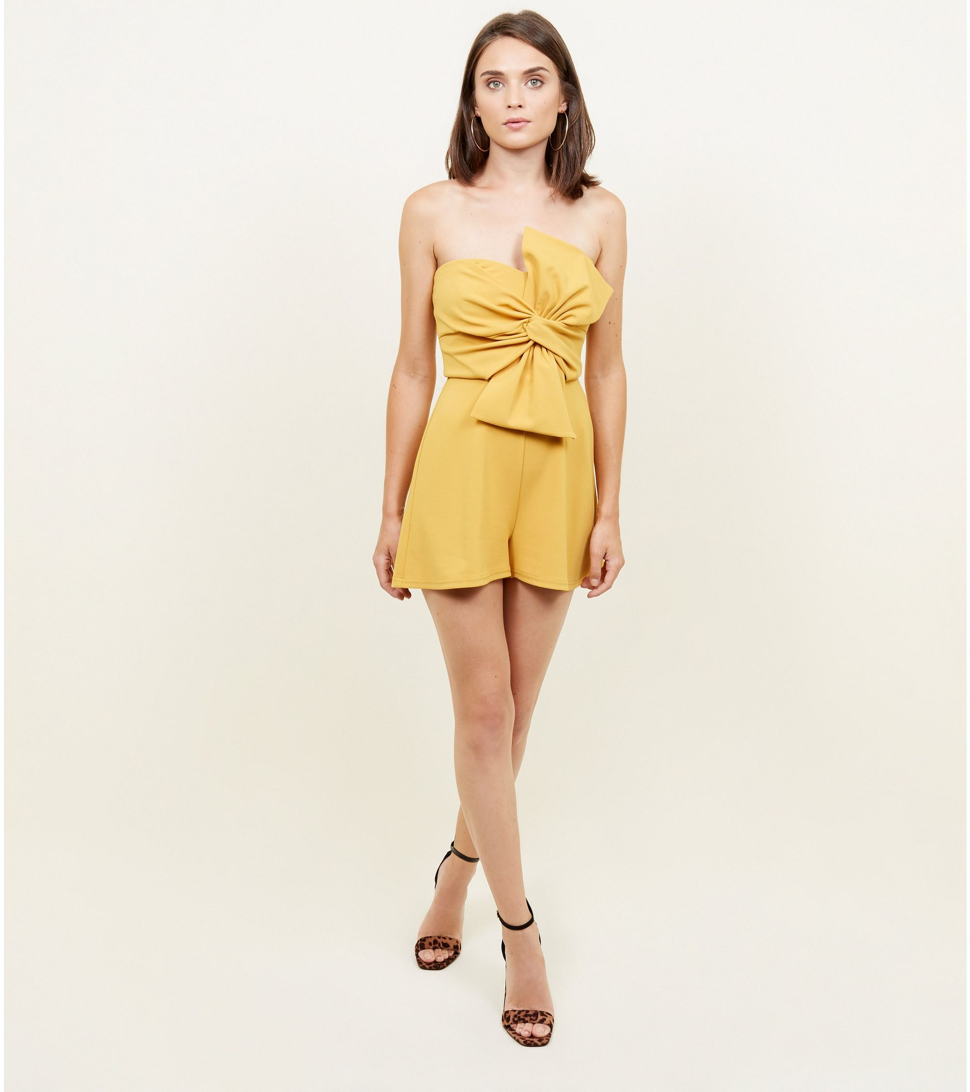 f7c18b69c6 New Look Yellow Bow Front Strapless Party Playsuit at £24.99