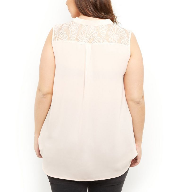 3766ba50bb6e2 ... Plus Size Shell Pink Lace Back Wrap Front Sleeveless Top. ×. ×. ×. Shop  the look