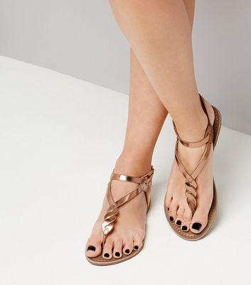 Sandales métallisées en cuir doré rose à entre doigt torsadé Ajouter à la Wishlist Supprimer de la Wishlist