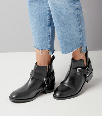 black-leather-buckle-cut-out-ankle-boots