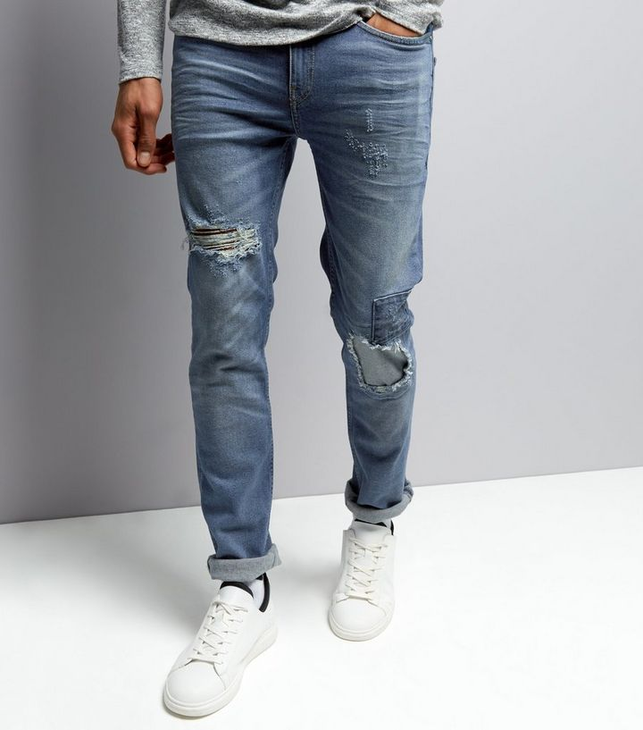 379ff8d82db Blue Ripped Patch Jeans