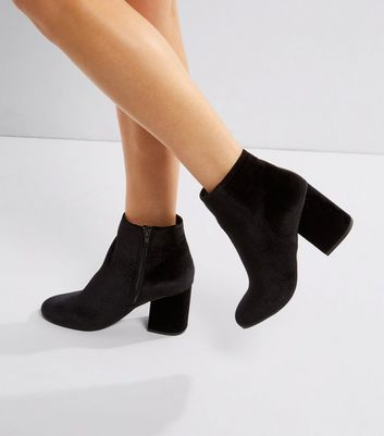 black velvet heeled boots