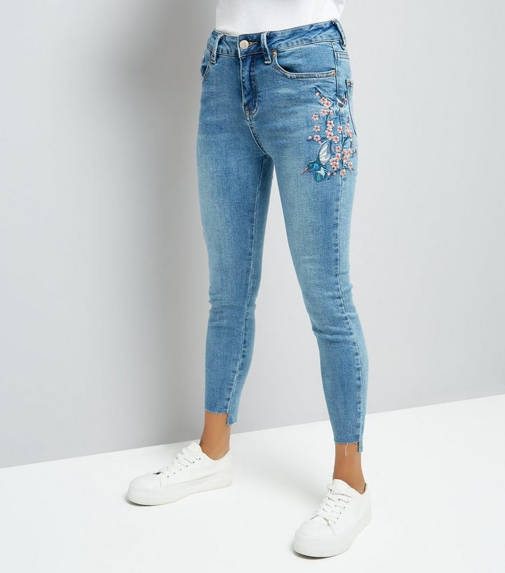 8571dcdbdb9a4 Petite Blue Bird Embroidered Skinny Jeans