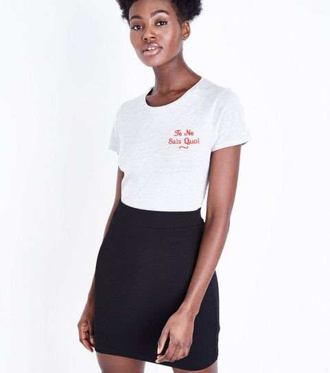 57c30309a6 ... Black Textured Mini Tube Skirt ...