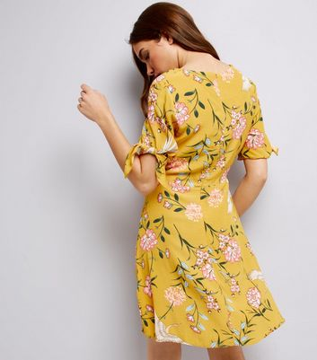 Yellow Floral Print Tie Sleeve Wrap Front Skater Dress New Look