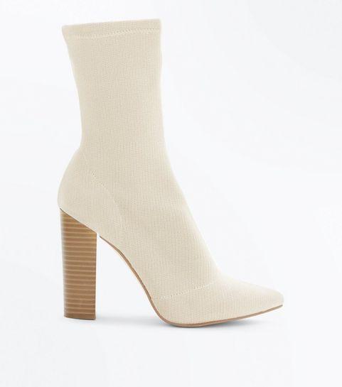 1f4f7a40b6f ... Bottes style chaussettes nude à talons bloc en maille ...