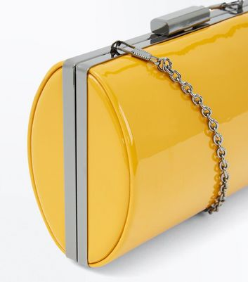 Yellow Patent Curved Box Clutch Bag New Look