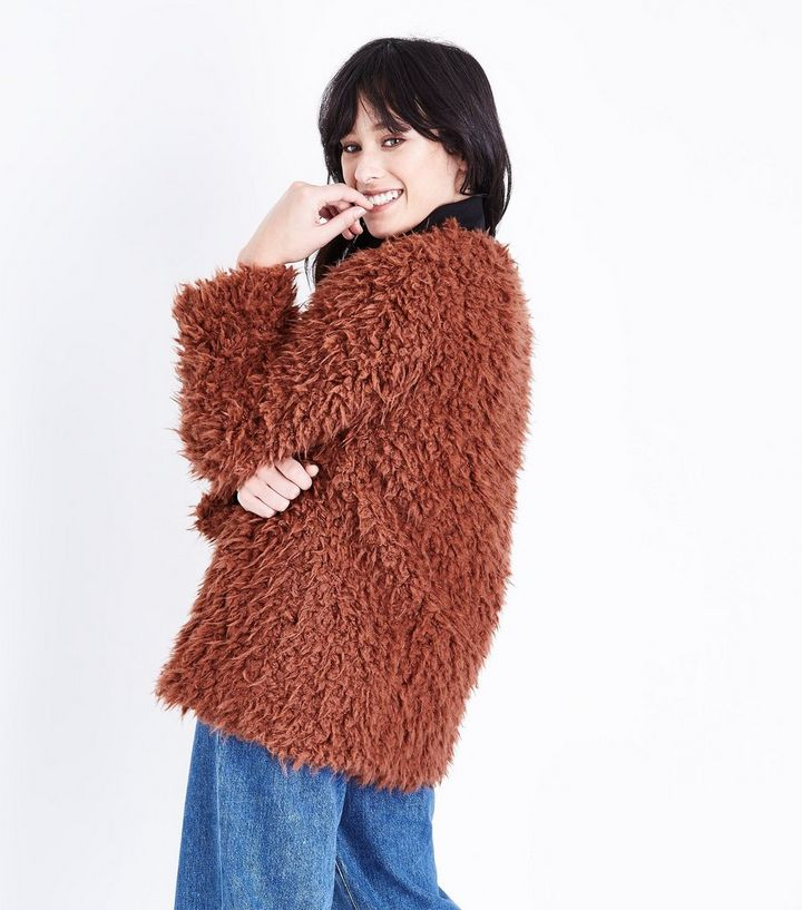 11cb64e35199 ... Rust Faux Sheepskin Coat. ×. ×. ×. Shop the look