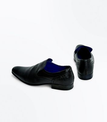 black-perforated-leather-loafers