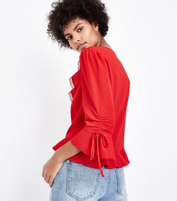 red-frill-front-lace-trim-peplum-top