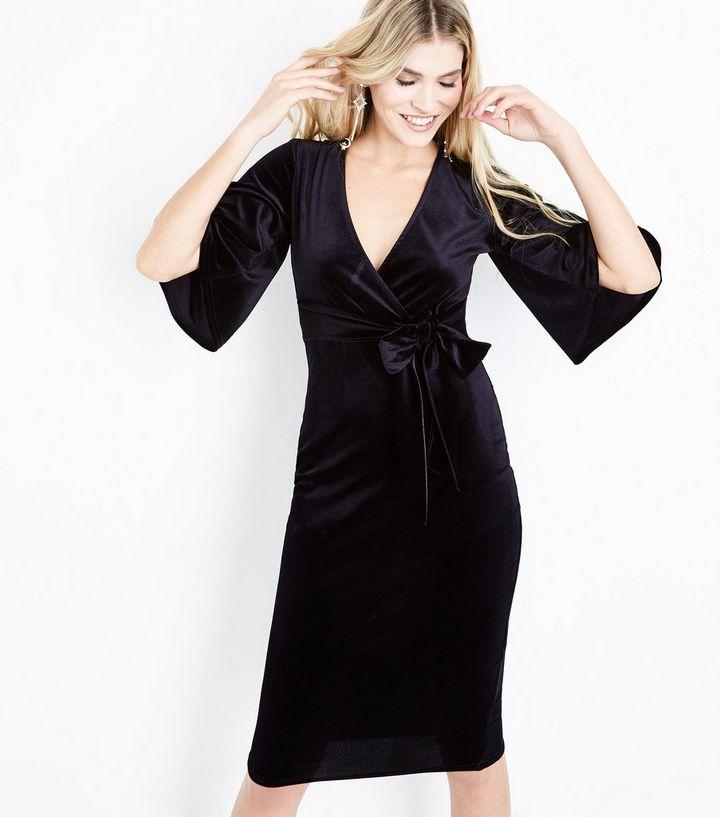 4d0be02d1c37 Robe mi-longue portefeuille noire en velours