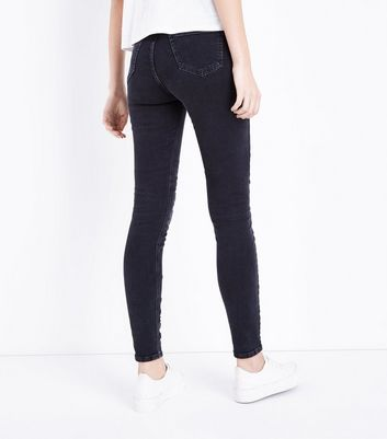 Tall Black Cut Out Hem Skinny Jeans New Look