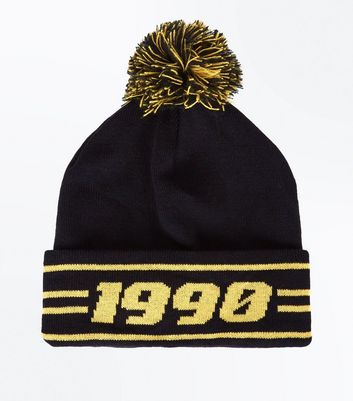 Photo of Black and yellow 1990 bobble beanie new look
