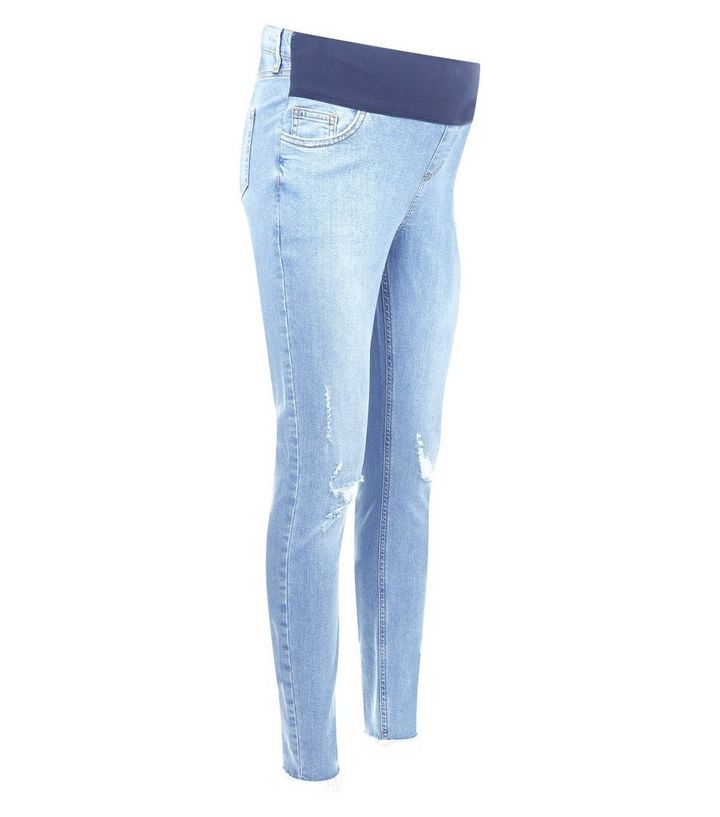 cb36123620c4f ... Maternity Pale Blue Ripped Raw Hem Under Bump Skinny Jeans. ×. ×. ×.  Shop the look