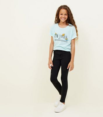 What shall in jeans skinny teen doing