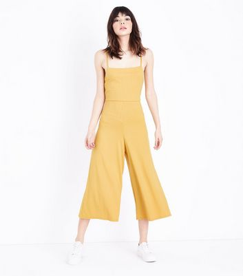 93ddccf9a2 NEW LOOK. YELLOW RIBBED STRAPPY SQUARE NECK CULOTTE JUMPSUIT