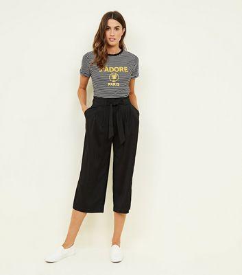 Pantalon large court noir noué à la taille