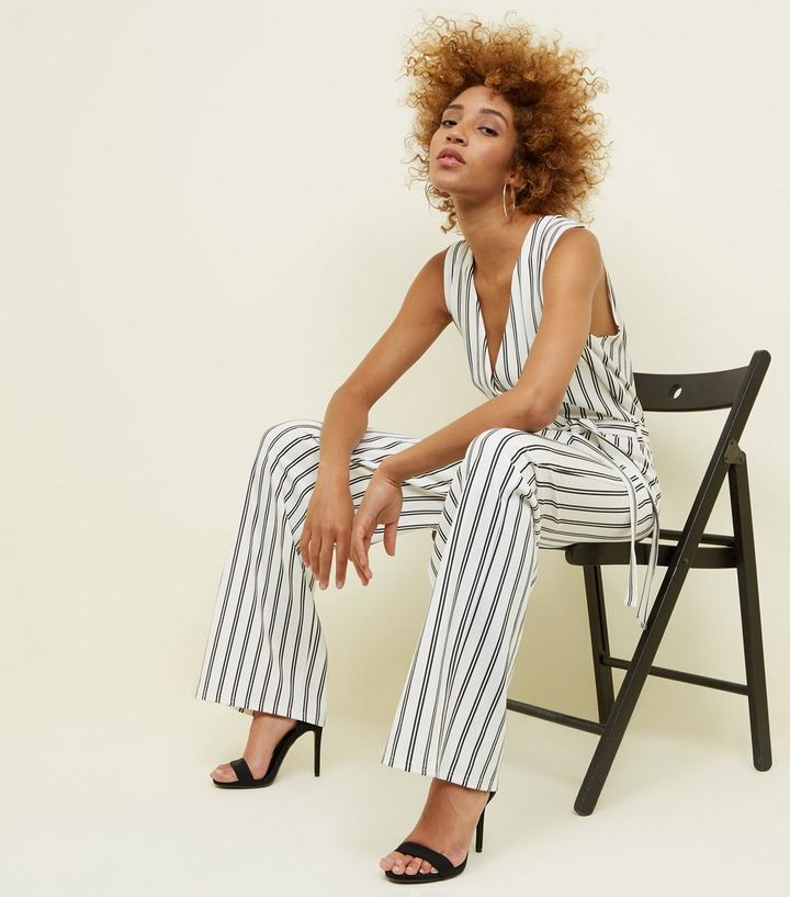 2179a56895b ... Cameo Rose White Stripe Wrap Jumpsuit. ×. ×. ×. Shop the look