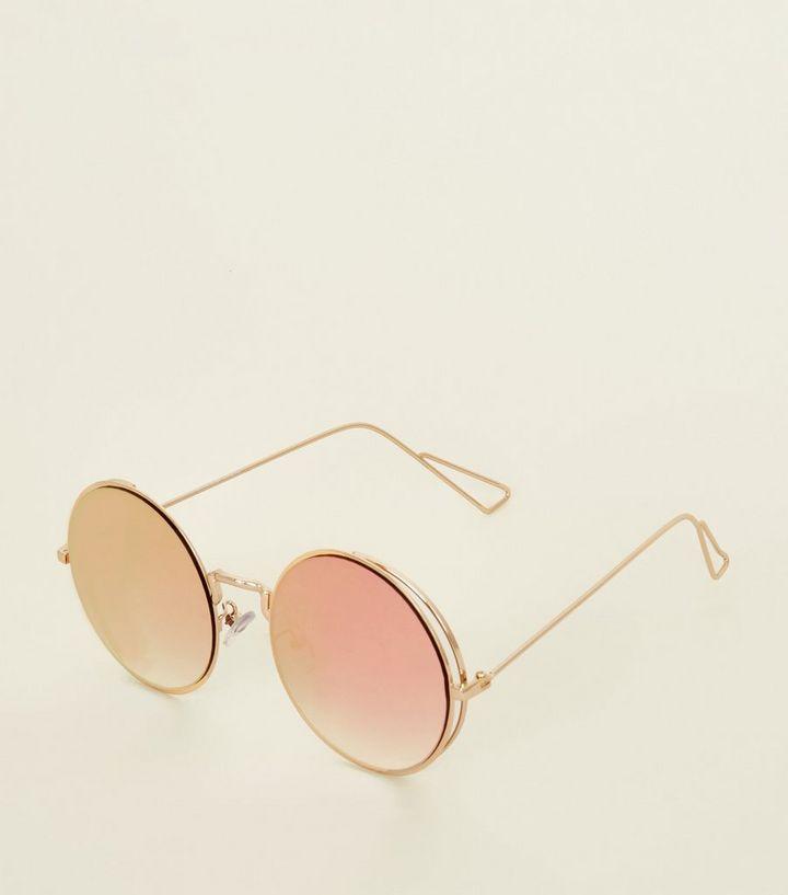5bf4b35421faa1 Lunettes de soleil rondes couleur or rose à verres effet miroir ...