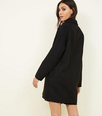 Schwarzer Mantel mit Raglanärmeln
