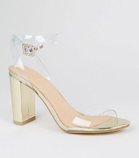 d0462a06777 ... Sandales dorées à talons blocs et à brides transparentes ...