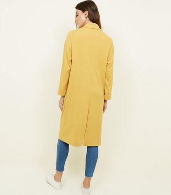 veste longue femme jaune moutarde