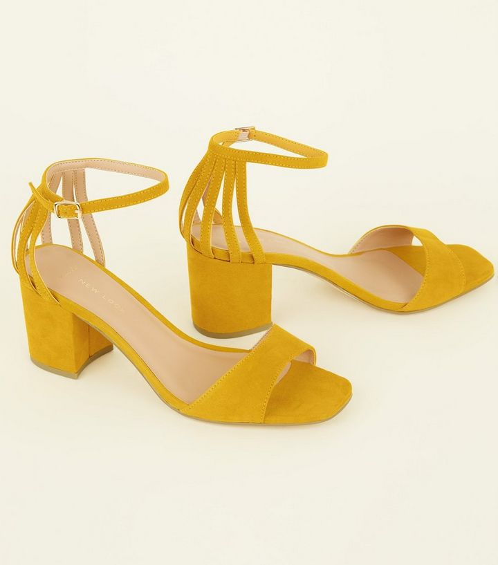 98ff7c136ba ... Wide Fit Mustard Cage Back Mid Heel Sandals. ×. ×. ×. Shop the look