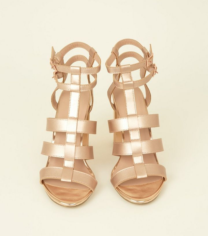 82c704bf988a ... Rose Gold Metallic Gladiator Block Heels. ×. ×. ×. Shop the look