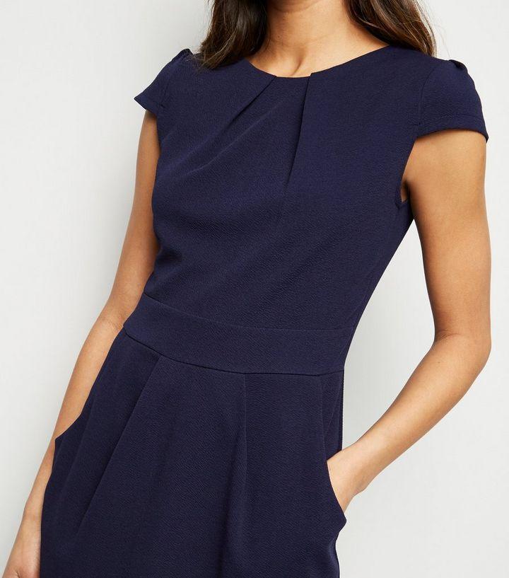 1f91ab3f406c19 ... Mela Navy Pocket Front Tulip Dress. ×. ×. ×. Shop the look