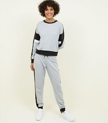 Sweat gris chiné color block