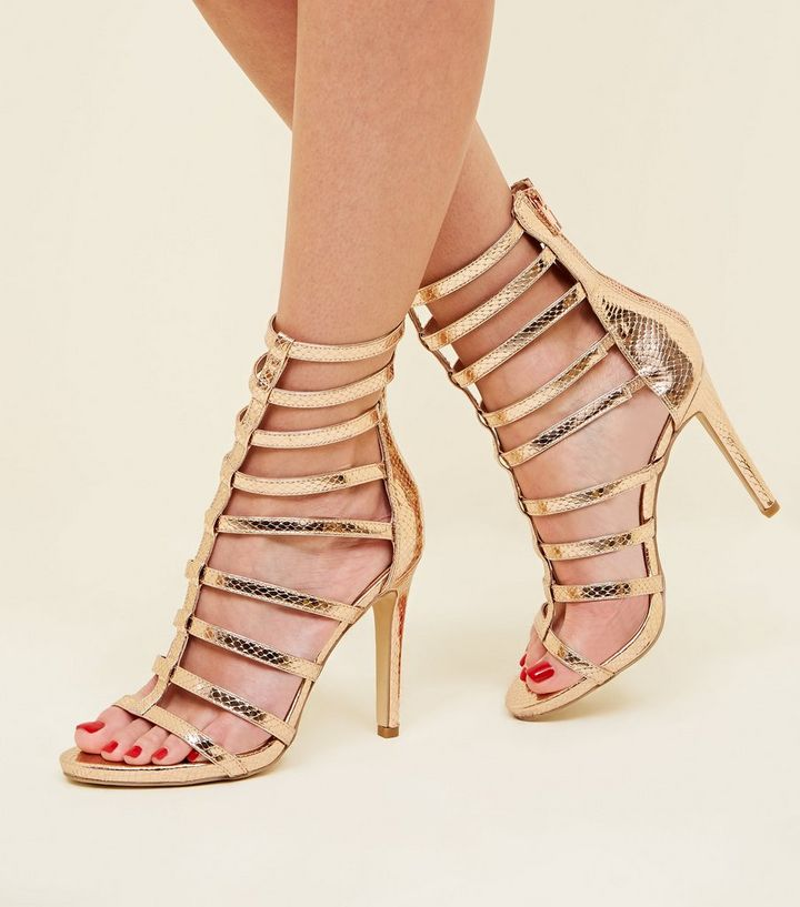 5b77cdc74d8d ... Rose Gold Faux Snake Stiletto Gladiator Sandals. ×. ×. ×. Shop the look