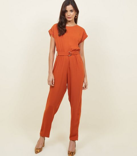 37b764ff9d ... Orange D-Ring Belted Jumpsuit ...