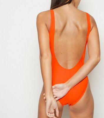 Click to view product details and reviews for Bright Orange Scoop Back Swimsuit New Look.