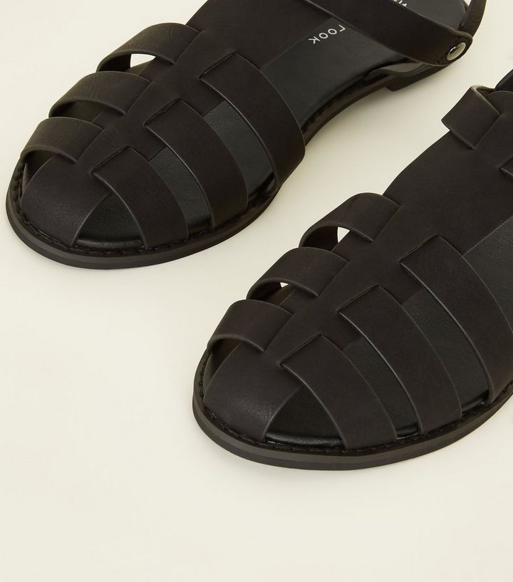 c2ea76d17a3d ... Black Leather-Look Caged Flat Sandals. ×. ×. ×. Shop the look