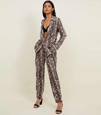 Cameo Rose Brown Snake Print Trousers