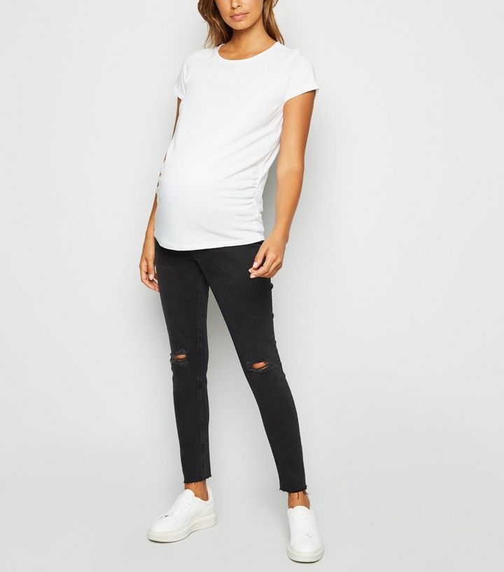 2a00e390c1e9e Maternity Black Ripped Knee Under Bump Skinny Jeans | New Look