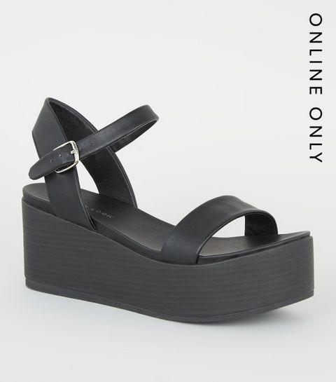 0c9cc8fcf96 ... Black Leather-Look Flatform Footbed Sandals ...