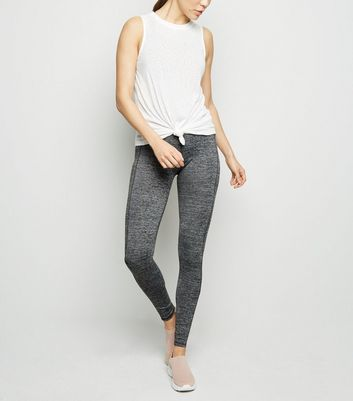 Legging de sport gris chiné à design color block en tulle