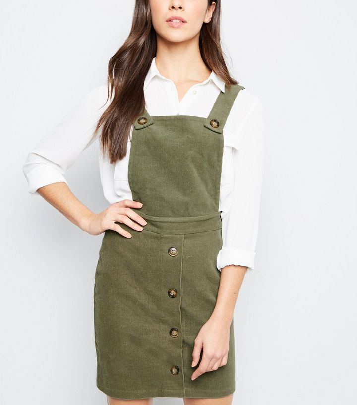 ceefe4f6b4 Khaki Corduroy Faux Horn Button Pinafore Dress | New Look